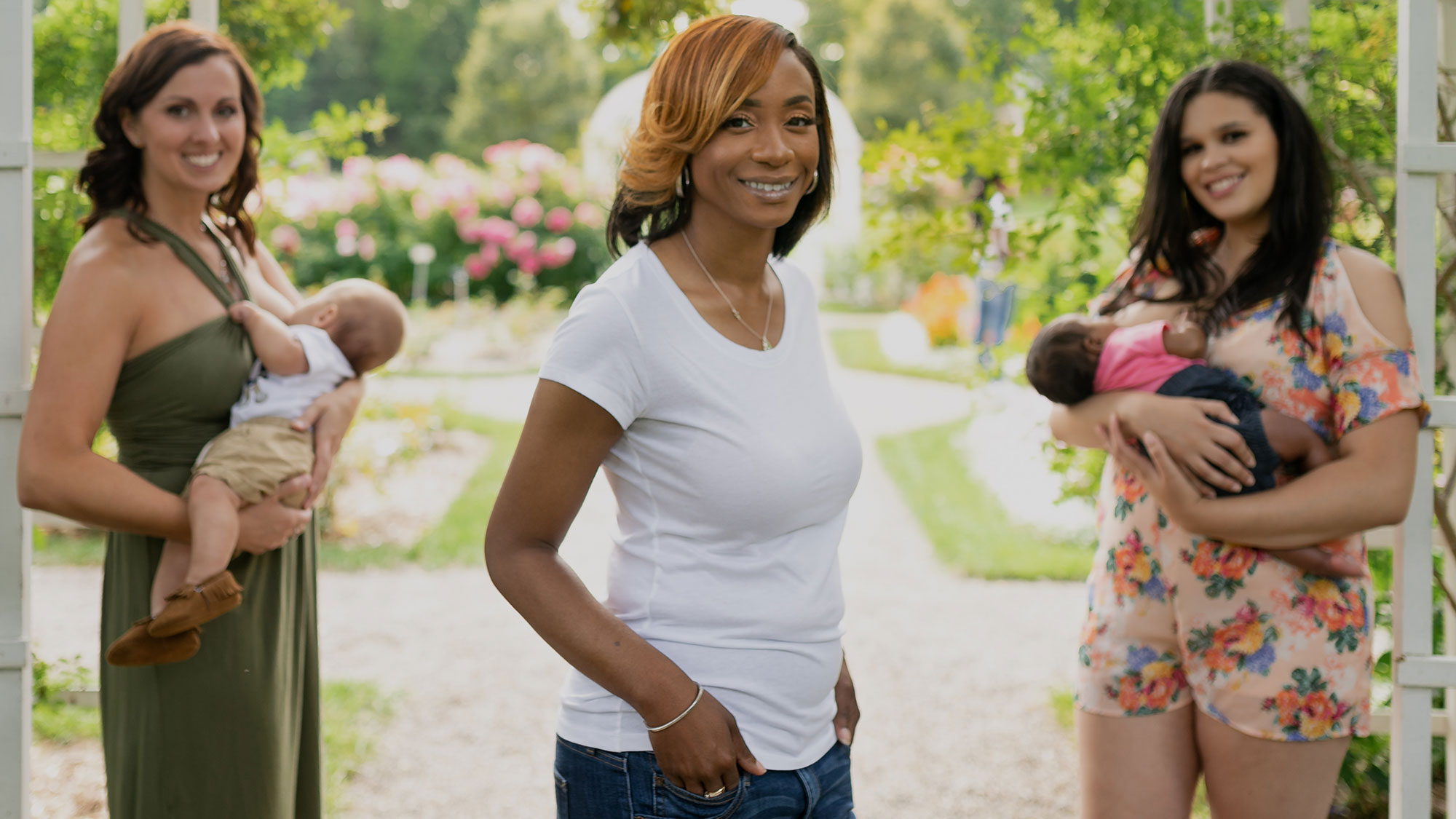 YOLO Breastfeed owner standing new to two women breastfeeding